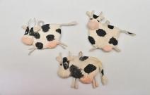 Ёлочная игрушка — коровы.